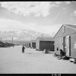 MANZANAR, California, 1943: Barracks at one of 10 internment camps where Japanese were imprisoned after the federal government forcibly relocated them from the West Coast. These camps were run by the War Relocation Authority. Many referred to these desolate facilities as concentration camps. Some Issei – first-generation Japanese immigrants – from Hawaii, the West Coast and Latin America along with smaller numbers of German and Italian Americans were sent to separate Justice Department camps. Ansel Adams / War Relocation Authority photo